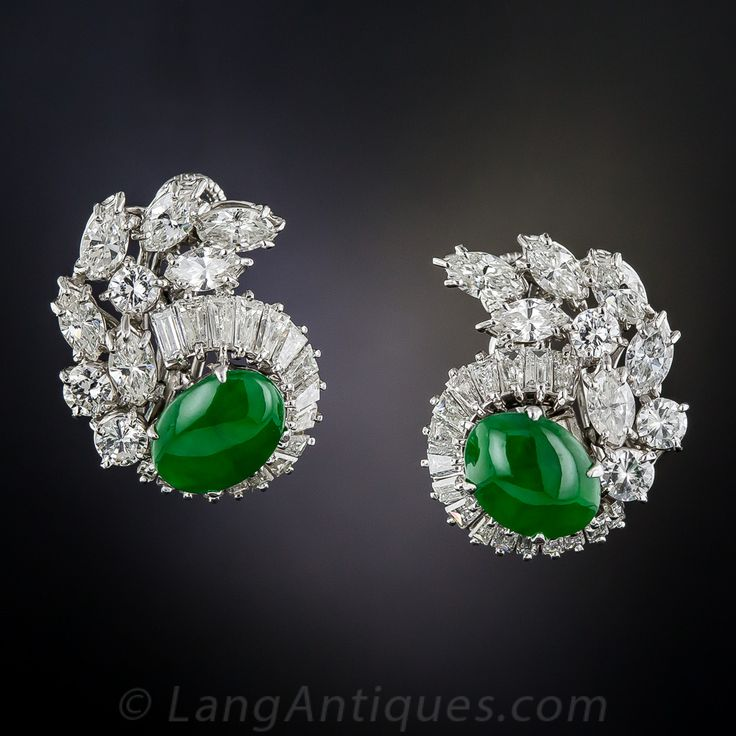 A matched pair of gorgeous green oval jades are augmented with resplendent platinum and diamonds in these fmagnificent, high-quality, platinum and diamond earrings, circa mid-twentieth century