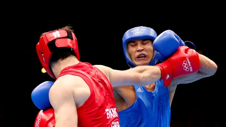 Olympics Day 16 - Boxing LONDON, ENGLAND - AUGUST 12:  (L-R) Freddie Evans of Great Britain exhanges punches with Serik Sapiyev GOLD of Kazakhstan during the Men's Welter (69kg) Boxing final bout on Day 16 of the London 2012 Olympic Games at ExCeL on August 12, 2012 in London, England.  (Photo by Scott Heavey/Getty Images)