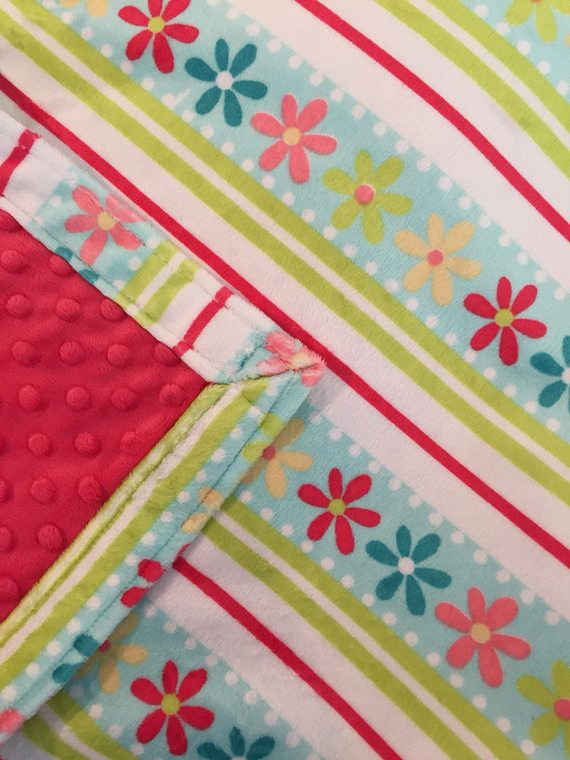 This blanket is the perfect size for the preschool cot, or toddler bed or stroller and makes a cozy and colorful gift. Many blankets have one layer of Minky fabric, but all of mine have two! Beautiful double layer Minky blanket floral in Cuddle Daisy Stripe Aqua featuring flowers.