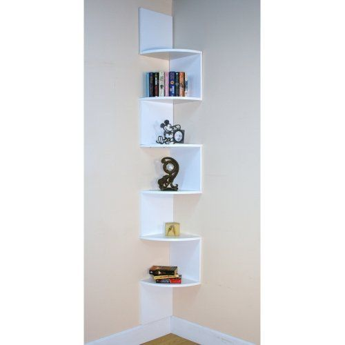 Funky corner shelf. I like that its one solid piece, so it should be easier to mount/hang.
