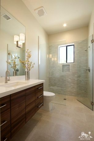 Contemporary 3/4 Bathroom with frameless showerdoor, Riobel - Single-Hole Faucet, Wall sconce, Limestone counters, Flush