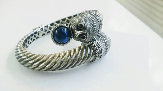 Check out this item in my Etsy shop https://www.etsy.com/uk/listing/563992533/double-lion-head-bracelet-with-lapis