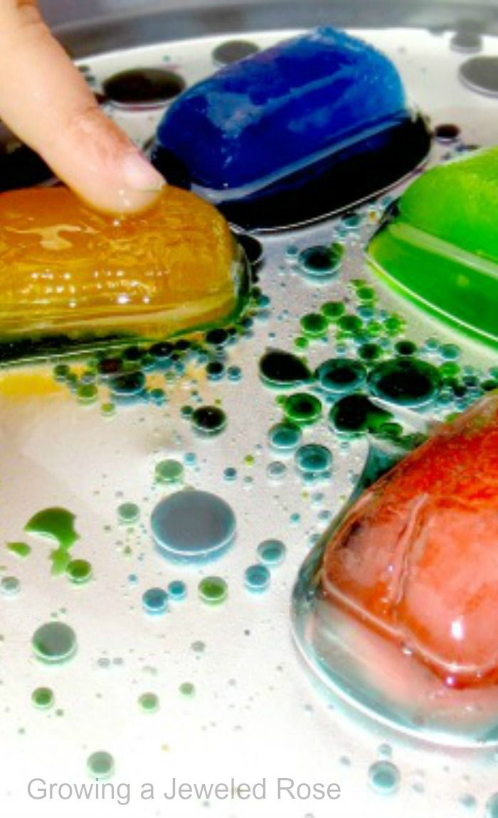 Summer Science Experiments with Oil and Ice- this experiment explores liquids, colors, reactions, and more! (The ice helps cool down a hot day, too! )