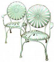 Vintage French pinwheel spring-steel garden chairs.