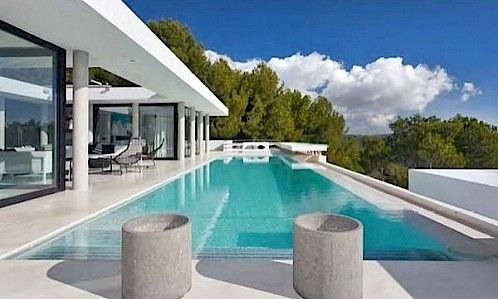 Villa Anke is a large contemporary waterfront property located on top of a hill overlooking the Mediterranean with a spectacular view of the old town of Ibiza, Playa d'en Bossa, Salinas, Cap des Falcó and Formentera.