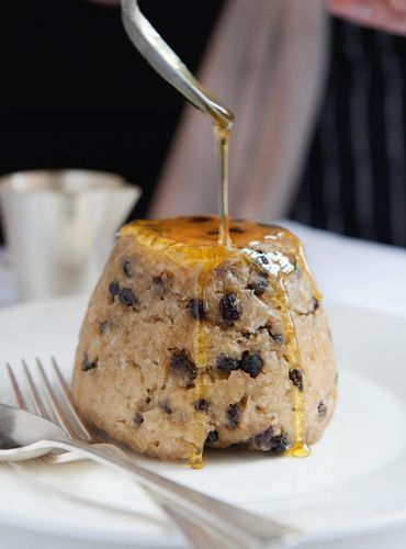 Spotted Dick with Butter, Golden Syrup and Custard from Tim Hughes' J Sheeky FISH. Drop into a steamer and cook for 1 1/2 hours before serving with all the trimmings.