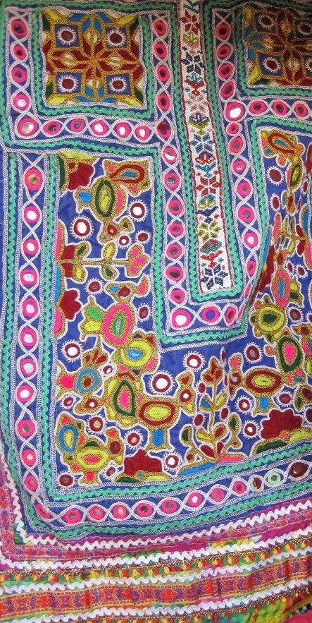 Colors of a barren Rann of Kutch - embroidered front panel of a Kutchi woman's dress #stitch #embroidery