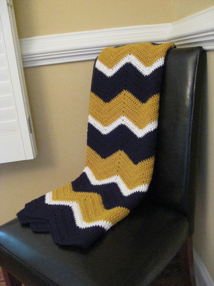 black, gold & white ripple afghan - am currently working on a ripple afghan such as this one, except I'm doing 4 rows of black, three rows of gold and 2 rows of white (my ripples will be black, gold then white). High School football season is coming and those bleachers can get rather cold on a Friday night. Go Sabers!