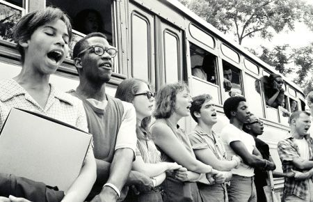 Freedom riders in Mississippi, in front of a bus.