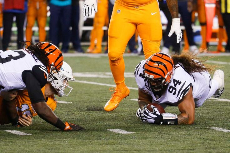 Cincinnati Bengals defensive tackle Domata Peko (94) recovers a fumble by Miami Dolphins quarterback Ryan Tannehill, second from left, during the first half of an NFL football game, Thursday, Sept. 29, 2016, in Cincinnati.