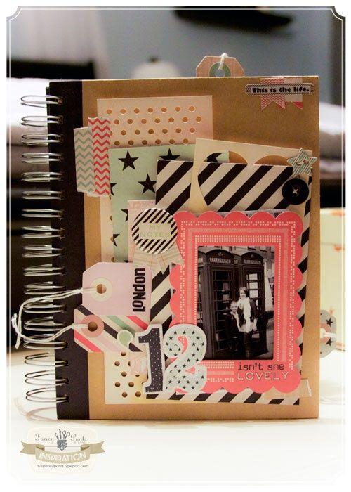 Cuaderno tipo álbum con arillo metálico