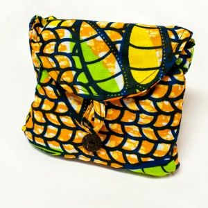 Folded African Shopping Tote | Amani Africa  Shop green and empower women in Liberia by purchasing this fair trade shopping tote. Folds out of itself into a bright shopping bag. $14