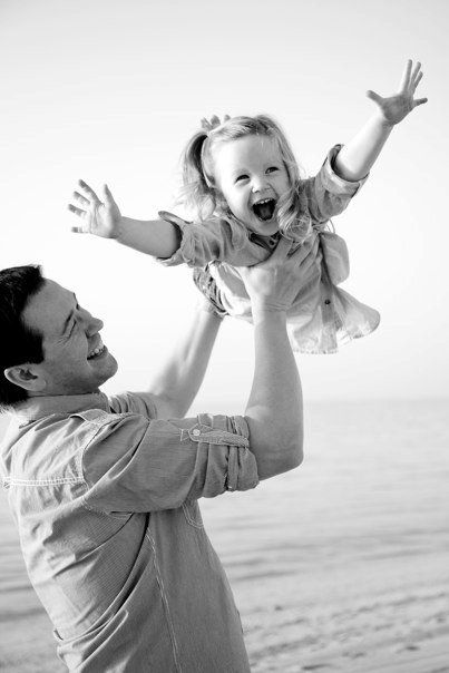 Reminds me of when I was little - my daddy used to throw me in the air and I used to laugh so much. - God i miss my Dad. What a mix of emotions this photo has brought, happy and sad.
