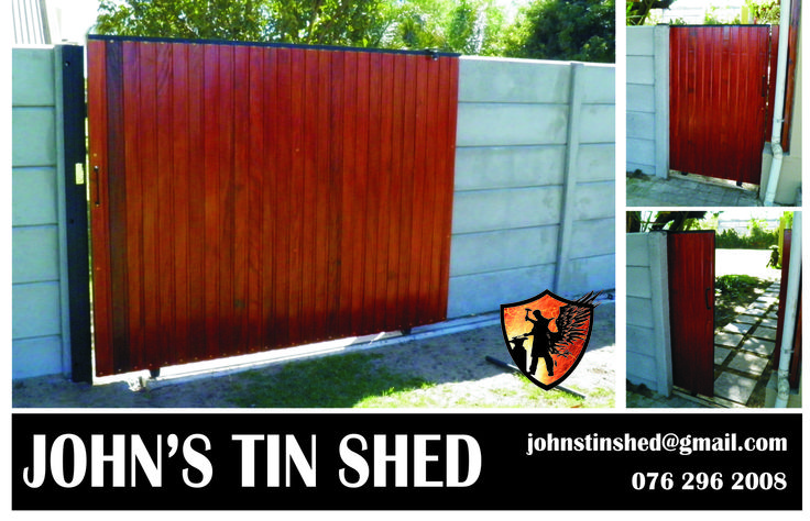 Sliding steel gates with timber cladding