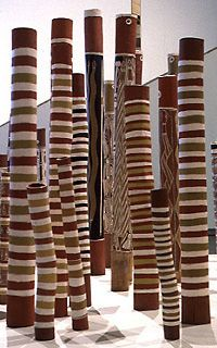 Aboriginal Memorial of 200 painted tree trunks commemorating all the indigenous people who had died between 1788 and 1988 defending their land against invaders. Each tree trunk is a dupun or log coffin, which is used to mark the safe tradition of the soul of the deceased from this world to the next.