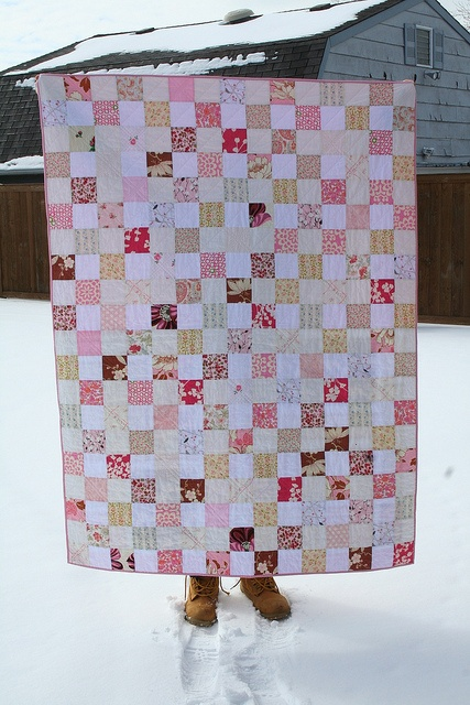 someday I will make a plain square quilt like this... minus the boots.