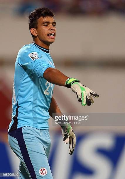 Goalkeeper Hamza Ben Chrifia of Tunisia gestures during the FIFA U17 World Cup UAE 2013 Group D match between Japan and Tunisia at Sharjah Stadium on...