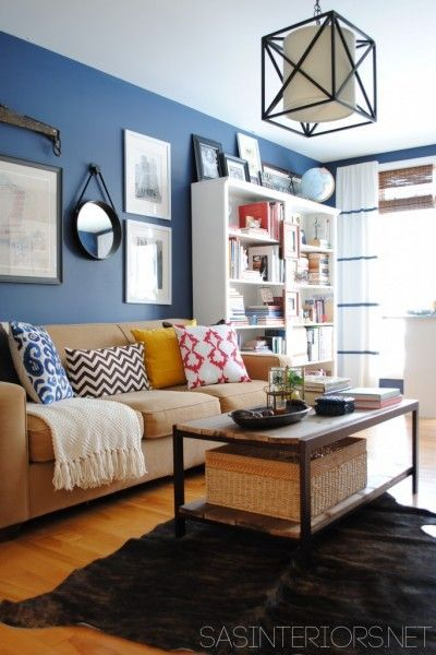 Like our living room. Blue wall, honey floors. LOVE the curtains. Fun and youthful. Lots of white. brown and black touches.
