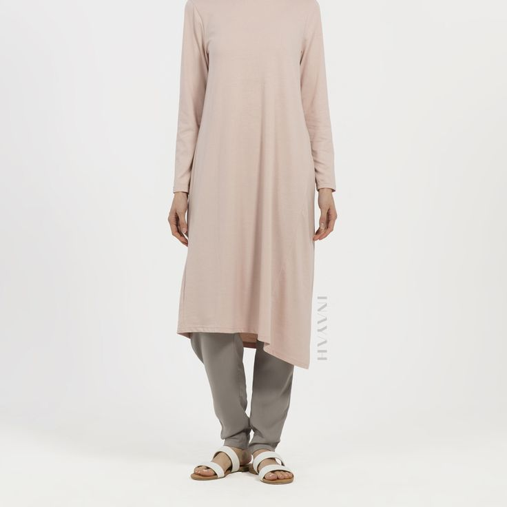 Fashion forward assymetric midis with panel detailing in beautiful blush tones. Blush Asymmetric Panel #Midi + Grey Crossover #Trousers - www.inayah.co