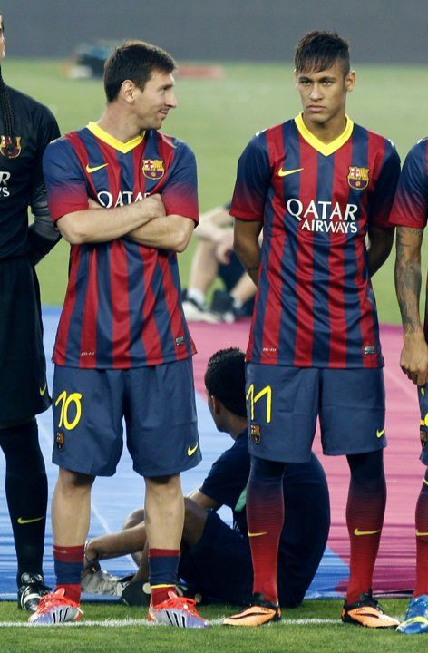 Barcelona's Lionel Messi looks at his team mate Neymar before their Joan Gamper trophy soccer match against Santos in Barcelona