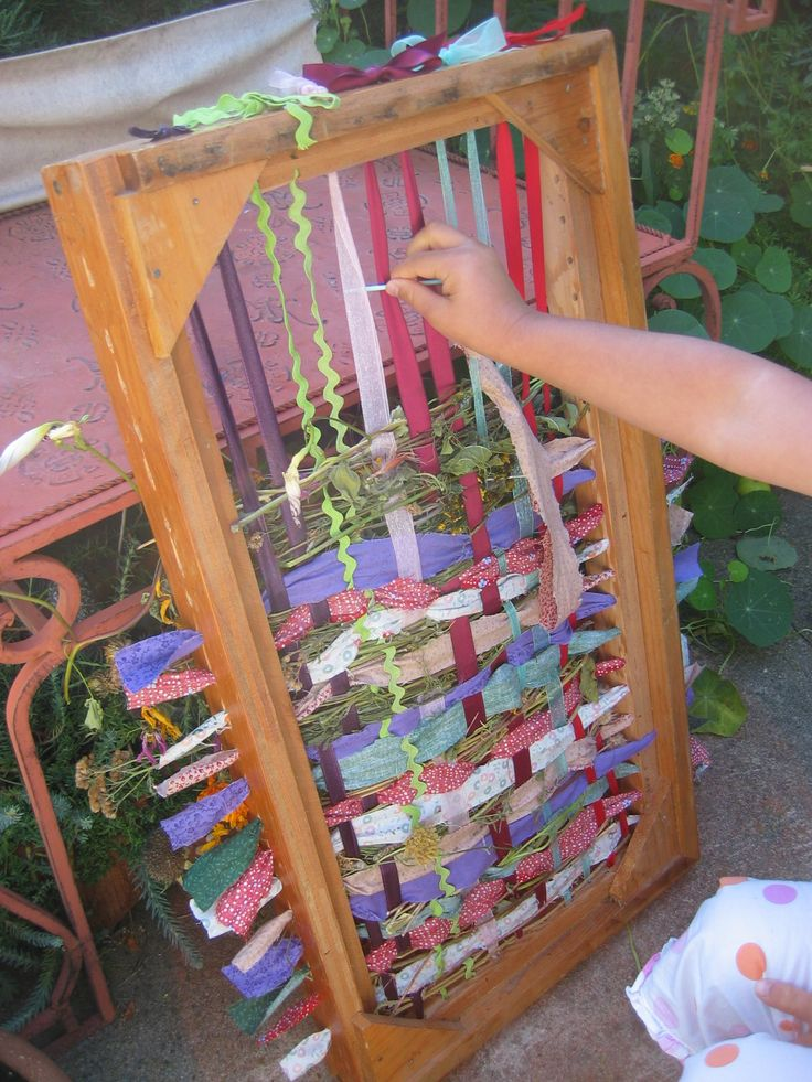 Use an old frame, ribbon, fabric scraps and nature goodies to create an oversized loom for the kids.