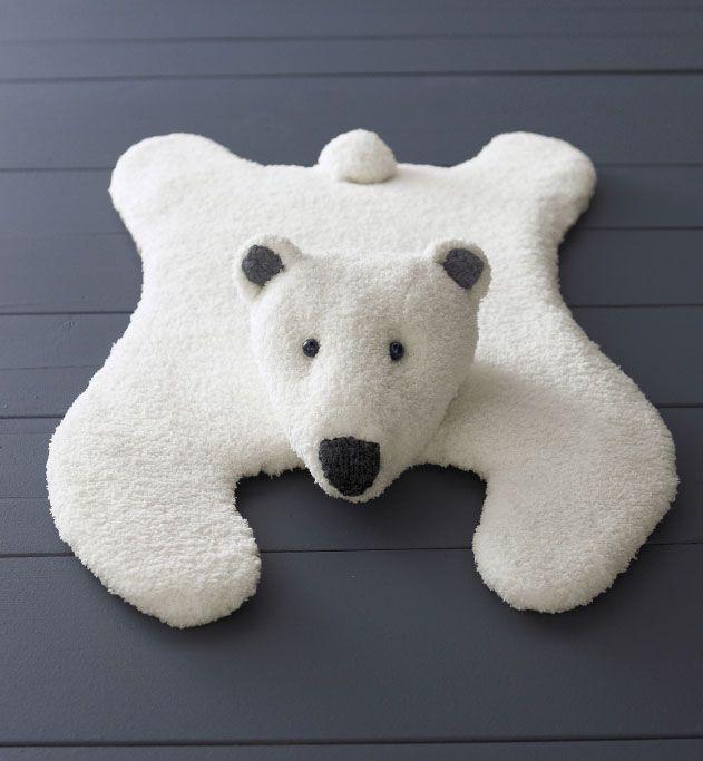 Modèle tapis ours jersey : Albert, l'ours polaire... comme une vraie peau de nounours ! Tapis ours bi-matière en Phil douce et Rapido, longueur 83 cm. Modèle tricoté en jersey. 2 boutons 12 mm pour les yeux.