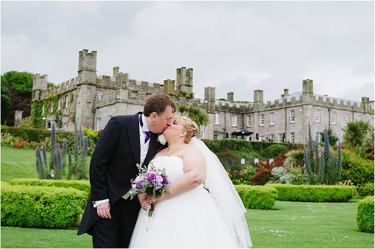 Bride and groom on the lawn at a Tregenna Castle wedding