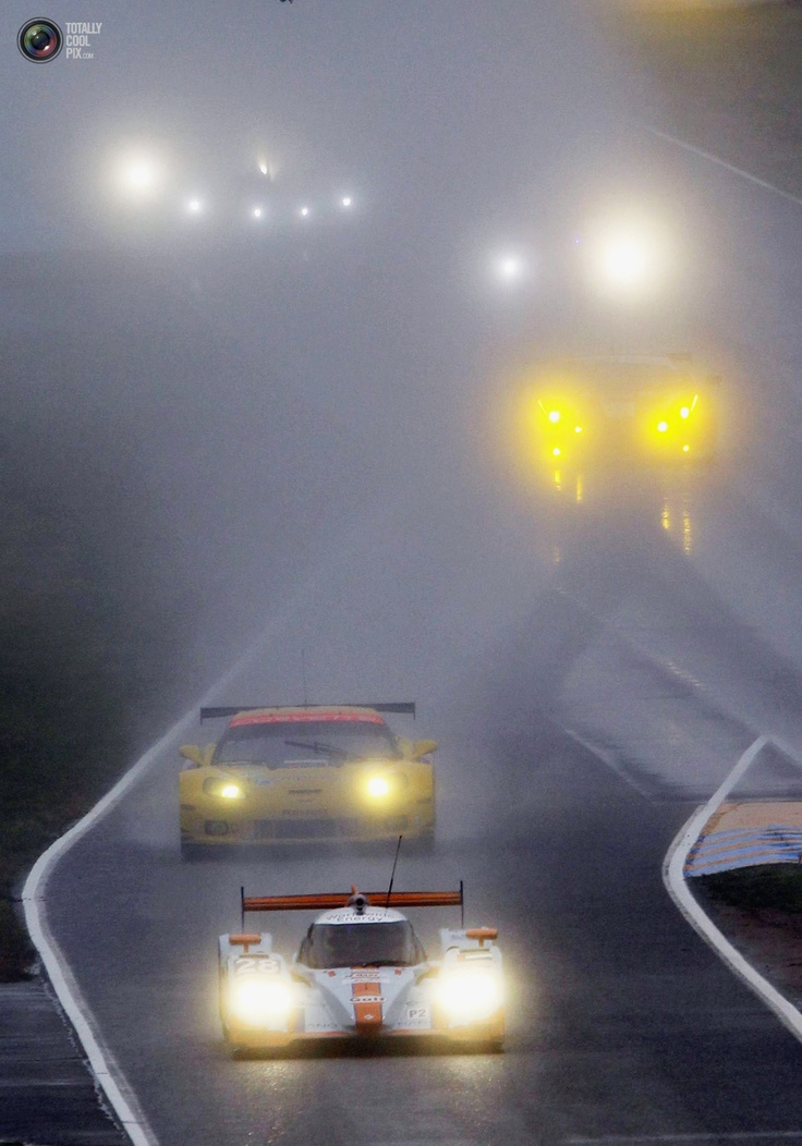 Competitors drive their cars in the rain during a warm-up session before the Le Mans 24-hour sportscar race in Le Mans. REGIS DUVIGNAU/REUTERS