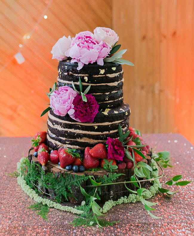 naked chocolate cake with peonies