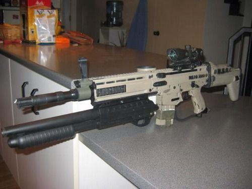 Scar with an under barrel 12 gauge shotgun called for 12 gauge door breaching