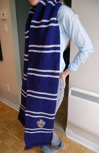 Ravenclaw Scarf. Perfect. The perfect blue and gray stipe size. And the emblems on it!!!! I want this. :)