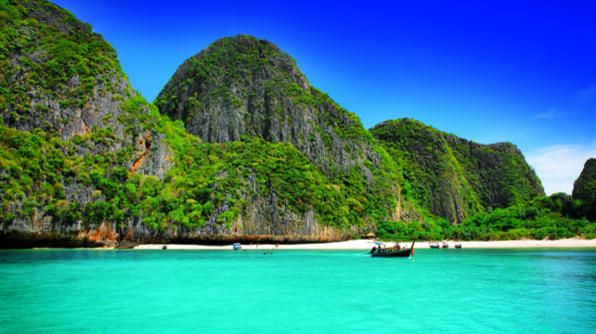 Brilliant turquoise waters lure travelers to the shores of Ko Phi Phi Don Island, Thailand. Bamboo Island, Laem Tong Beach, Loh Dalum, Koh Phi Phi Leh and Loh Bagao Bay are some of the beaches found around the island, but Long Beach is the most popular and a great spot for snorkeling, too.