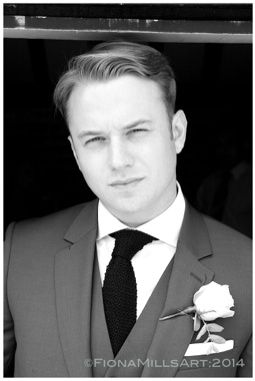 Groom pre wedding ceremony. Groom style. Wedding day style. Ushers, getting ready, almost at the ceremony. Bold, statement wedding day photography. High contrast black and white edit. Blue suit, black textured tie, blond short hair, side swept make style.