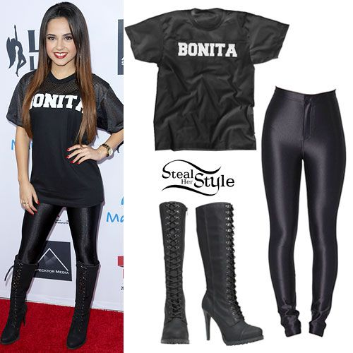 """Becky G arrived at the 5th annual Rock The Red Kettle Concert to benefit the Salvation Army yesterday wearing a black Kulture L.A. """"Bonita"""" Customized Jersey Mesh T-Shirt ($35.00), with her favorite American Apparel Black Disco Pants ($85.00), and her Aldo Olerani Tall Lace-Up Boots ($84.00)."""
