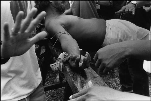 Abbas    PHILIPPINES. Pampanga district. Village of Santa Lucia. 1995.Crucifixion of a fidel during Good Friday.