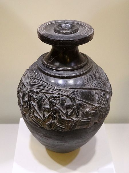 The Minoan stone vessel known as the 'Harvester Vase', from Hagia Triada on Crete, 1500-1450 BCE. The vase is carved from serpentine and was originally covered in gold leaf. The scenes in relief depict a sowing festival. (Archaeological Museum of Heraklion, Crete).