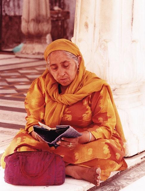 Sitting and reading - Punjabi lady