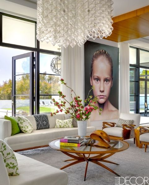 Balance bold artwork with subtle curtains in a bright living room for the perfect balance.