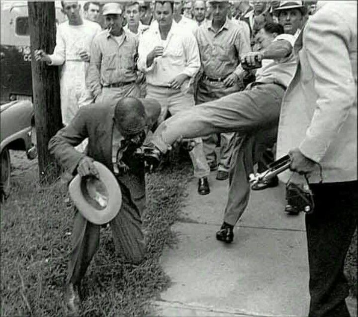 A black man on his way to vote is assaulted - kicked in the face - by a group of angry whites. ALWAYS use your vote!