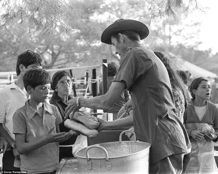British troops hand out food rations to Cypriot refugees during the crisis