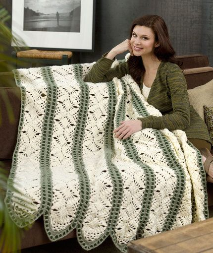 Many of you will know the name Trish Kristoffersen from her amazing, intricate doilies, so it should come as no surprise that Trish designed this beauty.  This afghan is stitched first in panels, making it an excellent take-along project, then they are joined together to form an exquisite