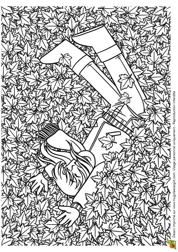 Coloriage / dessin automne se jeter dans les feuilles