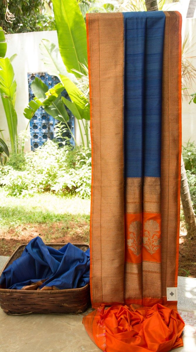 This Benares tussar has a lovely texture and is in blue. The border and pallu…