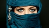 Burqa : Portrait of an arabic young woman with her beautiful blue eyes in traditional islamic cloth niqab Stock Photo