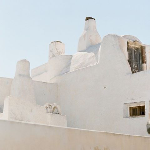 I love places with interesting ancient architecture like Pyrgos on Santorini. Taken with a medium format Contax 645 #