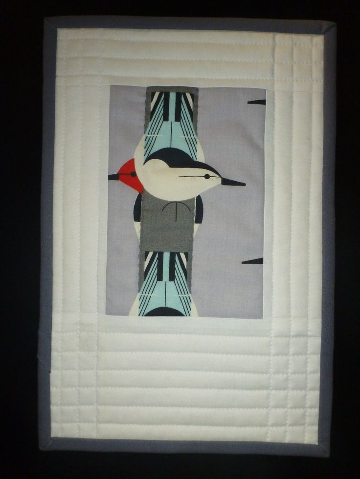 A very small wall quilt made from a scrap of Charlie Harper fabric. Made by Jean MacKie, Prince Edward Island.