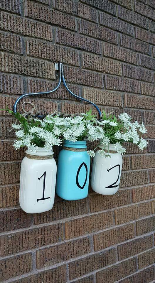 This would be perfect for a farm style house, mason jars hanging from an old rake!