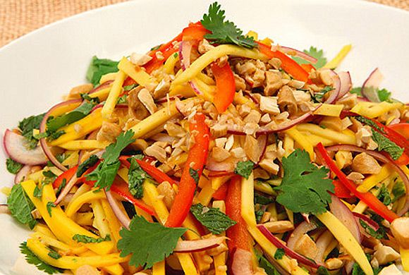 THAI MANGO SALAD  Inspired by the popular Thai salad, this green mango salad recipe will wake up your senses.Tangy and full of texture, this cashew-studded salad travels well for pot lucks and makes a great starter or side to just about anything.