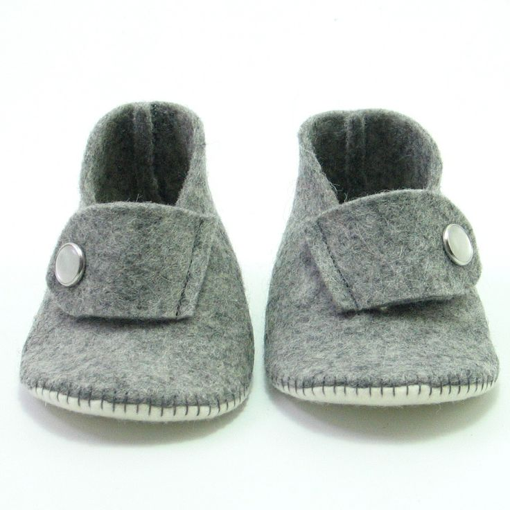 Mixed grey and cream, handmade wool felt babyshoes with a button in mother-of-pearl. Approximate price $27, worldwide shipping.