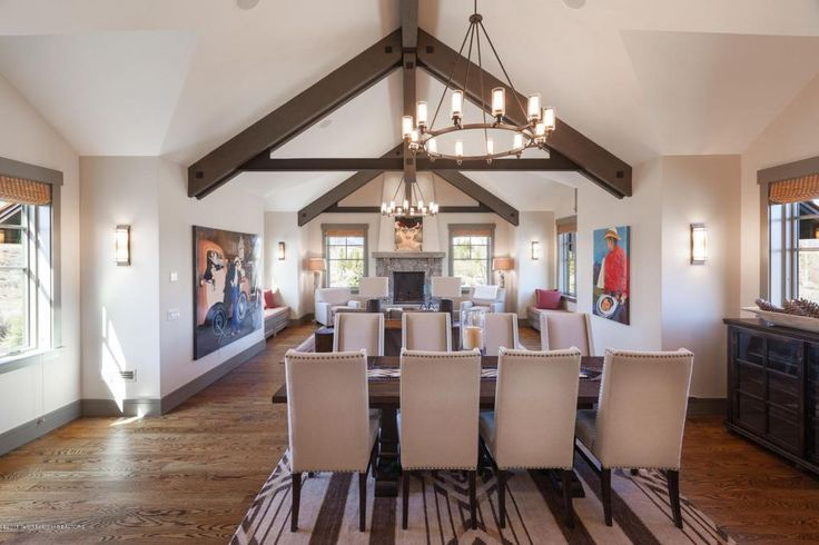 Mediterranean Dining Room with Hardwood floors, Exposed beam, Wall sconce, Chandelier, Carpet, Cathedral ceiling